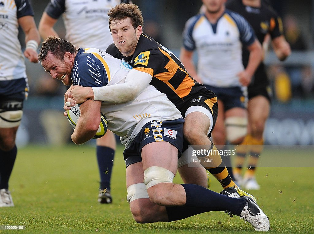 Dean Schofield of Worcester Warriors is tackled by Elliot Daly of London Wasps during the LV= Cup match between London Wasps and Worcester Warriors at Adams Park on November 18, 2012 in High Wycombe, England.