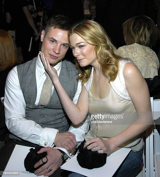 Dean Sheremet and LeAnn Rimes during Olympus Fashion Week Fall 2006 J Mendel Front Row and Backstage at Bryant Park in New York City New York United...