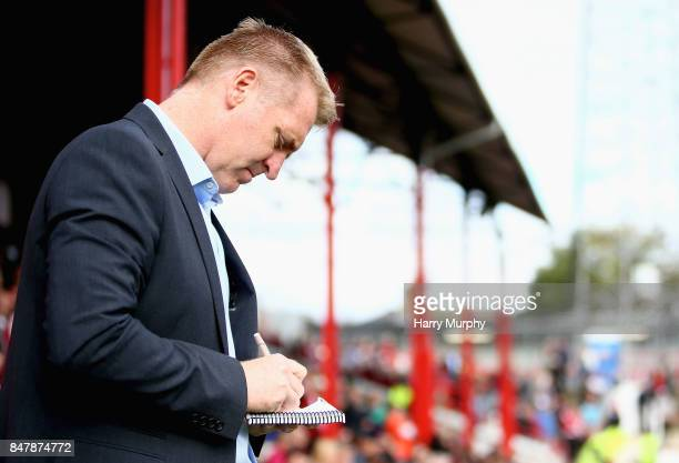 Dean Smith Head Coach of Brentford makes notes prior to the Sky Bet Championship match between Brentford and Reading at Griffin Park on September 16...