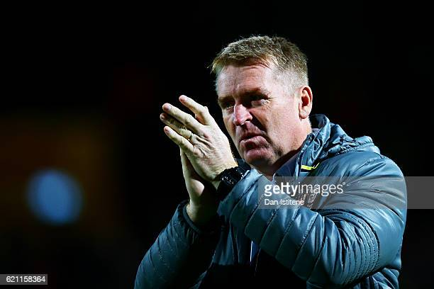 Dean Smith manager of Brentford applauds the fans before the Sky Bet Championship match between Brentford and Fulham at Griffin Park on November 4...