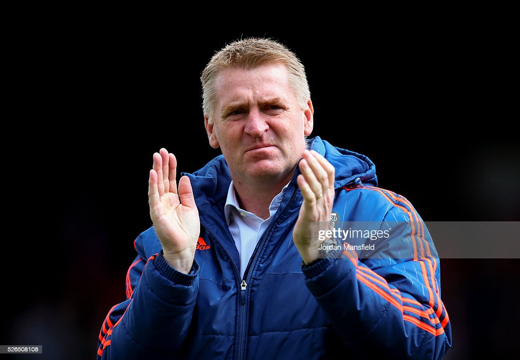 Dean Smith, manager of Brentford looks on prior to the Sky Bet Championship match between Brentford and Fulham at Griffin Park on April 30, 2016 in Brentford, England.