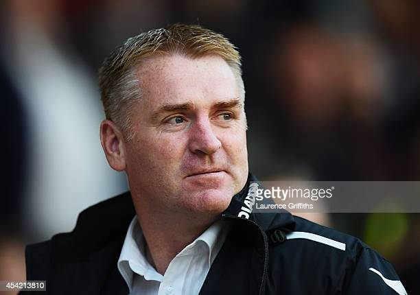 Dean Smith manager of Walsall looks on prior to the Capital One Cup Second Round match between Walsall and Crystal Palace at Banks' Stadium on August...
