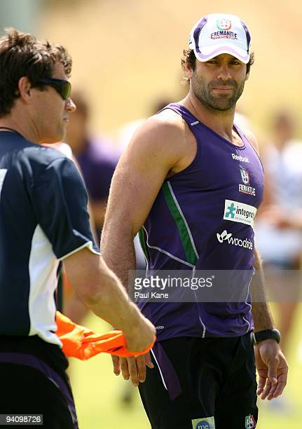 Dean Solomon of the Dockers looks back at Mark Harvey coach of the Dockers during a Fremantle Dockers AFL training session at Santich Park on...