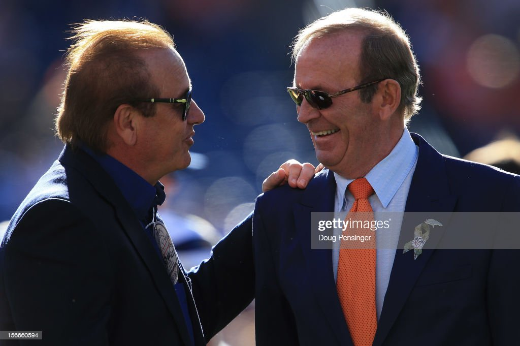 Dean Spanos, Chairman of the Board and President of the San Diego Chargers talks with Pat Bowlen, Owner and CEO of the Denver Broncos prior to their game at Sports Authority Field at Mile High on November 18, 2012 in Denver, Colorado.