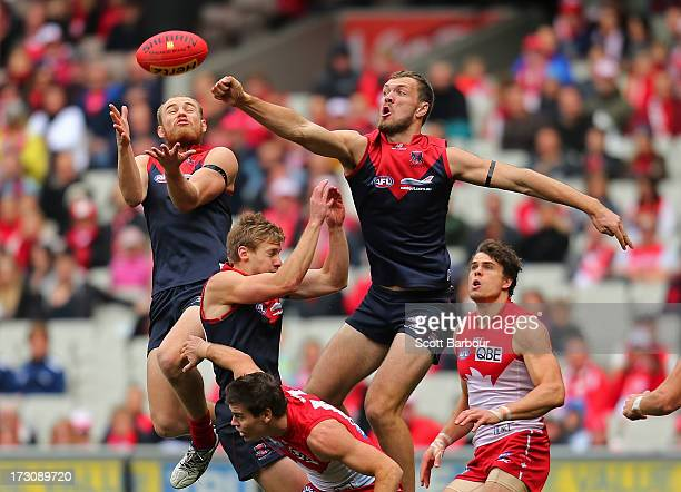 Dean Terlich and Max Gawn of the Demons compete for the ball during the round 15 AFL match between the Melbourne Demons and the Sydney Swans at...