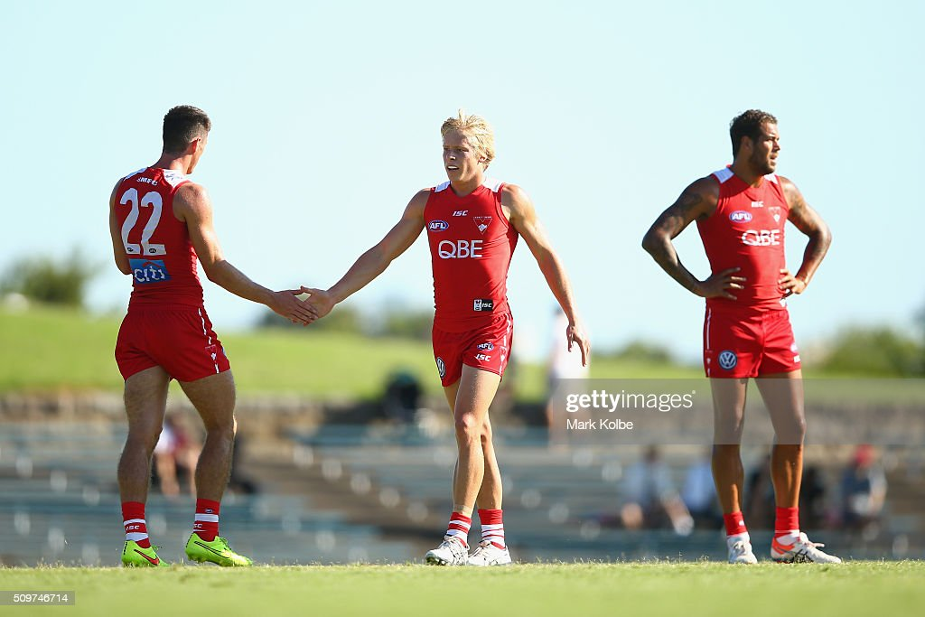 Dean Towers amd Isaac Heeney of the Red Team celebrate a goal during the Sydney Swans AFL intra-club match at Henson Park on February 12, 2016 in Sydney, Australia.