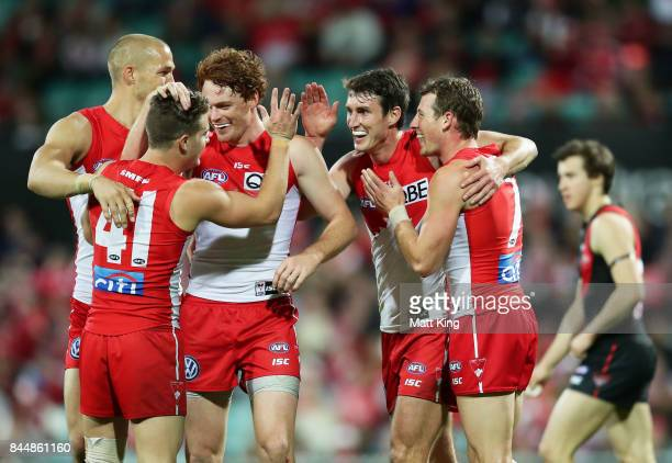 Dean Towers of the Swans celebrates with team mates after kicking a goal during the AFL Second Elimination Final match between the Sydney Swans and...