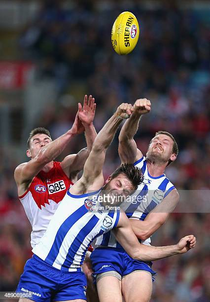 Dean Towers of the Swans competes for the ball against Luke McDonald and Lachlan Hansen of the Kangaroos during the First AFL Semi Final match...