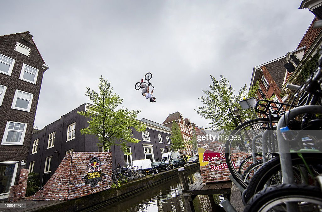 CREDIT 'AFP PHOTO / HO / RED BULL / Dean TREML' This handout photo received from Red Bull and taken on May 13, 2013 shows Daniel Wedemeijer of the Netherlands backflipping across Passeerdersgracht canal during a video production in preparation for next month's Red Bull Framed Reactions BMX event in Amsterdam.. The event will feature the usual structures with the added challenge of moving parts. AFP PHOTO / HO / RED BULL / Dean TREML