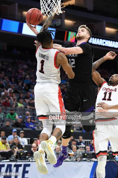 Dean Wade of the Kansas State Wildcats attempts a shot defended by Jacob Evans of the Cincinnati Bearcats during the first round of the 2017 NCAA...