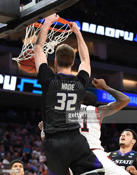 Dean Wade of the Kansas State Wildcats dunks the ball against the Cincinnati Bearcats during the first round of the 2017 NCAA Men's Basketball...