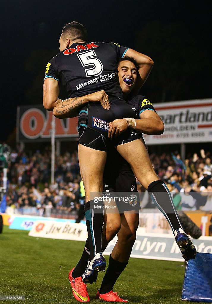 Dean Whare and Dallin WateneZelezniak of the Panthers celebrate a try by Dallin during the round 26 NRL match between the Penrith Panthers and the...