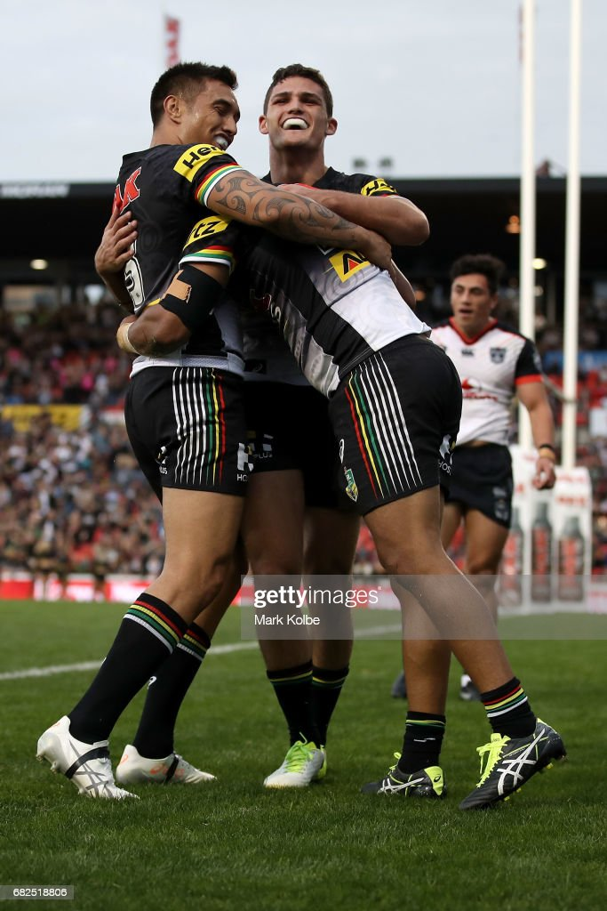 Dean Whare and Nathan Cleary of the Panthers congratulate Tyrone Peachey of the Panthers as he celebrates scoring a try during the round 10 NRL match between the Penrith Panthers and the New Zealand Warriors at Pepper Stadium on May 13, 2017 in Sydney, Australia.