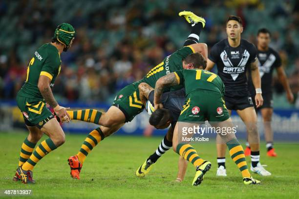 Dean Whare of the Kiwis is is tackled during the ANZAC Test match between the Australian Kangaroos and the New Zealand Kiwis at Allianz Stadium on...