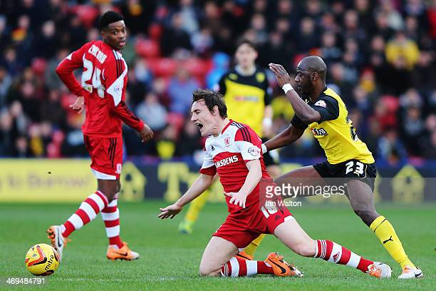 Dean Whitehead of Middlesbrough is challenged by Samba Diakite of Watford during the Sky Bet Championship match between Watford and Middlesbrough at...