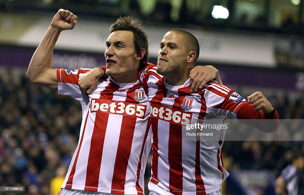 <a gi-track='captionPersonalityLinkClicked' href=/galleries/search?phrase=Dean+Whitehead&family=editorial&specificpeople=185232 ng-click='$event.stopPropagation()'>Dean Whitehead</a> (L) of Stoke celebrates with Michael Kightlt after scoring the first goal during the Barclays Premier League match between West Bromwich Albion and Stoke City at The Hawthorns on December 1, 2012 in West Bromwich, England.