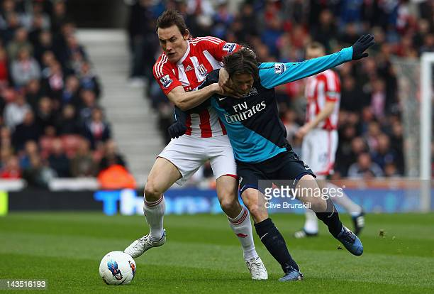 Dean Whitehead of Stoke City holds off Tomas Rosicky of Arsenal during the Barclays Premier League match between Stoke City and Arsenal at Britannia...