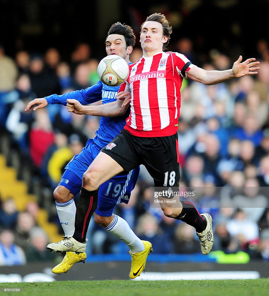 <a gi-track='captionPersonalityLinkClicked' href=/galleries/search?phrase=Dean+Whitehead&family=editorial&specificpeople=185232 ng-click='$event.stopPropagation()'>Dean Whitehead</a> of Stoke City is challenged by <a gi-track='captionPersonalityLinkClicked' href=/galleries/search?phrase=Paulo+Ferreira+-+Soccer+Player&family=editorial&specificpeople=185237 ng-click='$event.stopPropagation()'>Paulo Ferreira</a> of Chelsea during the FA Cup sponsored by E.on Quarter Final match between Chelsea and Stoke City at Stamford Bridge on March 7, 2010 in London, England.