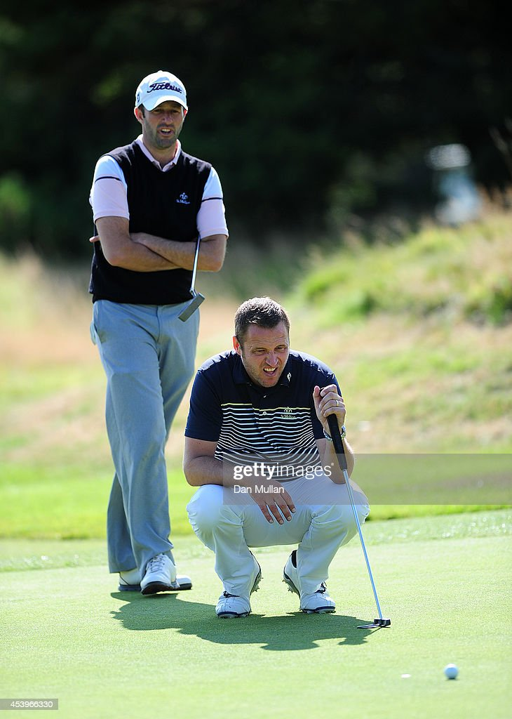 Dean Whitelock of St Mellion Golf Country Club lines up a shot with his partner Paul Hendricksen of Dinnaton Golf Club on the 17th hole during day...