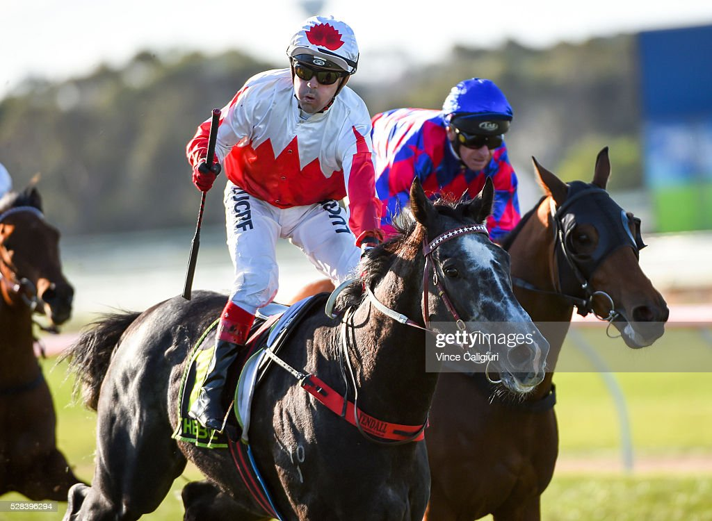 Dean Yendall riding Master of Arts celebrates on the line to win Race 8, the Warrnambool Cup during Grand Annual Day at Warrnambool Race Club on May 5, 2016 in Warrnambool, Australia.