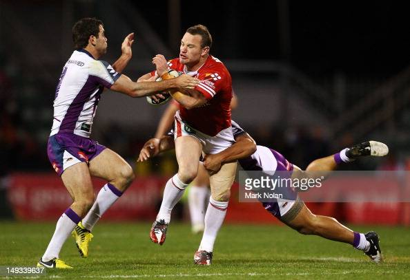 Dean Young of the Dragons is tackled during the round 21 NRL match between the St George Illawarra Dragons and the Melbourne Storm at WIN Stadium on...