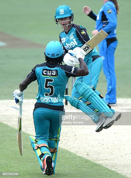 Deandra Dottin and Beth Mooney of the Heat celebrate victory during the Women's Big Bash League match between the Adelaide Strikers and the Brisbane...