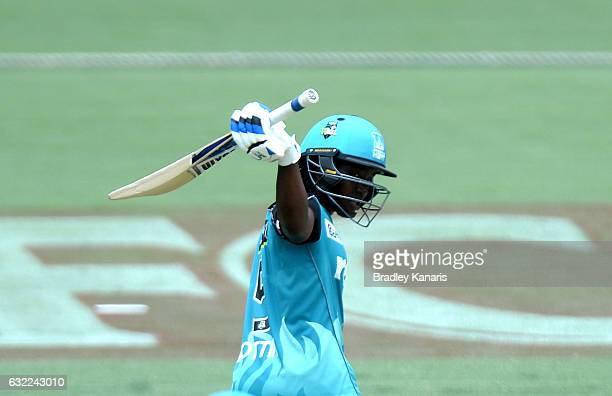Deandra Dottin of the Heat celebrates fater scoring her half century during the Women's Big Bash League match between the Adelaide Strikers and the...