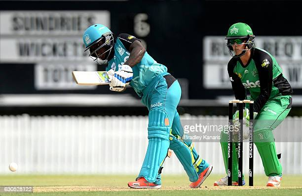 Deandra Dottin of the Heat plays a shot during the WBBL match between Melbourne Stars and Brisbane Heat at Allan Border Field on December 26 2016 in...