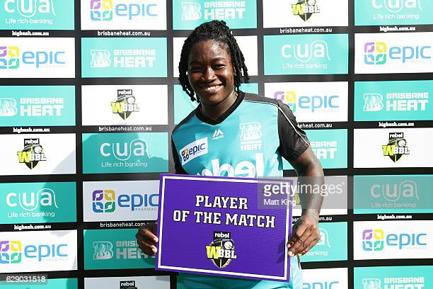 Deandra Dottin of the Heat poses with the Player of the Match Award during the Women's Big Bash League match between the Sydney Sixers and the...