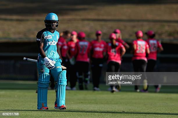 Deandra Dottin of the Heat walks back to the pavilion after being dismissed by Sarah Aley of the Sixers during the Women's Big Bash League match...
