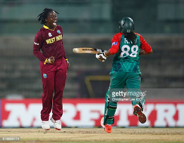 Deandra Dottin of the West Indies celebrates taking the wicket of Ritu Moni of Bangladesh during the Women's ICC World Twenty20 India 2016 Group B...