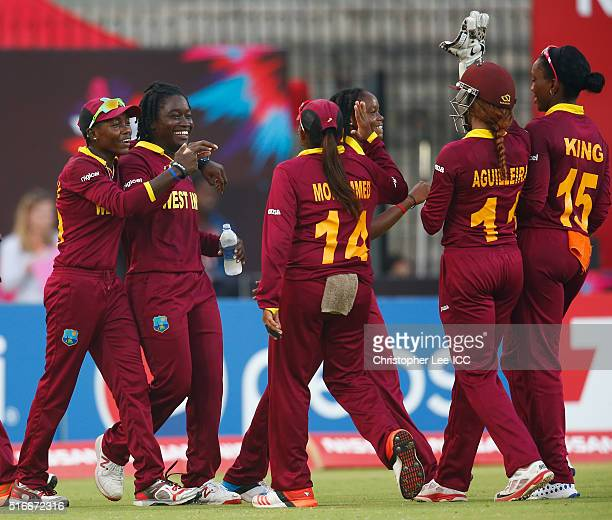 Deandra Dottin of the West Indies is congratulated after catching out Sanjida Islam of Bangladesh during the Women's ICC World Twenty20 India 2016...