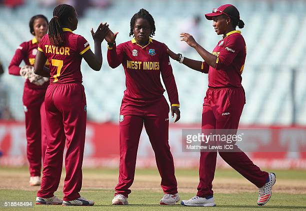 Deandra Dottin of the West Indies is congratulated on the wicket of Elyse Villani of Australia after she was caught by Stafanie Taylor Captain of the...