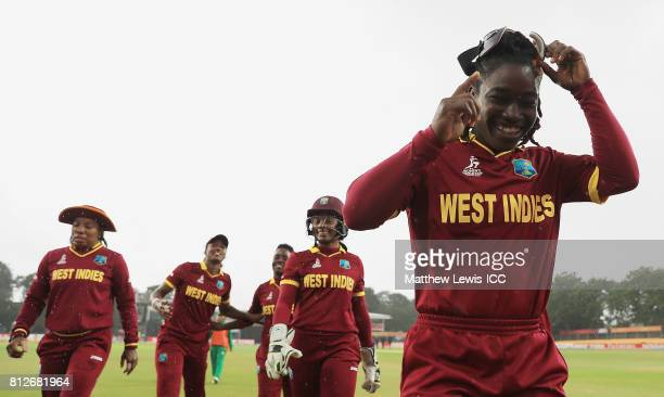 Deandra Dottin of the West Indies looks on after rain stops play during the second innings during the ICC Women's World Cup 2017 match between West...
