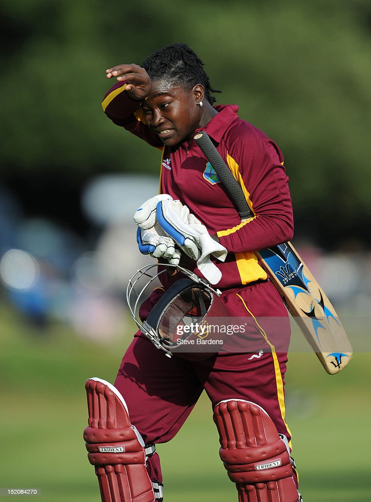 Deandra Dottin of the West Indies wipes her brow after her 62 run stand during the NatWest Women's International T20 Series match between England Women and West Indies Women at Arundel on September 16, 2012 in London, England.