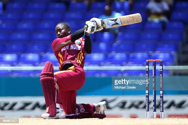 Deandra Dottin of West Indies hits to the offside on her way to an undefeated century during the ICC T20 Women's World Cup Group A match between West...