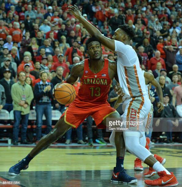 Deandre Ayton of the Arizona Wildcats drives to the basket against Brandon McCoy of the UNLV Rebels during their game at the Thomas Mack Center on...