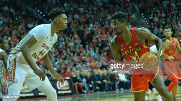 Deandre Ayton of the Arizona Wildcats looks to drive against Brandon McCoy of the UNLV Rebels during their game at the Thomas Mack Center on December...