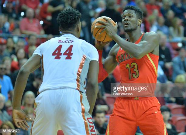Deandre Ayton of the Arizona Wildcats looks to pass against Brandon McCoy of the UNLV Rebels during their game at the Thomas Mack Center on December...