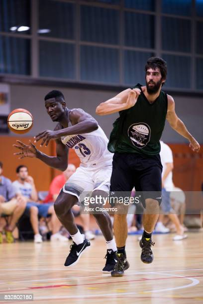 Deandre Ayton of the Arizona Wildcats loses the ball under pressure from Gerbert of the Mataro AllStars during the Arizona In Espana Foreign Tour...