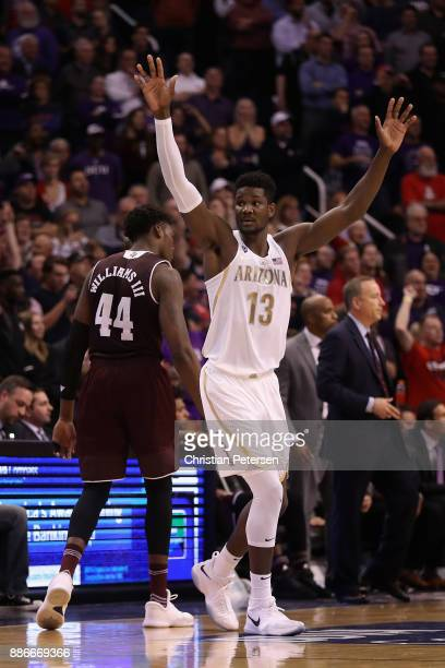Deandre Ayton of the Arizona Wildcats reacts alongside Robert Williams of the Texas AM Aggies after winning in the college basketball game at Talking...