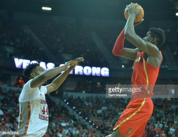 Deandre Ayton of the Arizona Wildcats shoots against Brandon McCoy of the UNLV Rebels during their game at the Thomas Mack Center on December 2 2017...