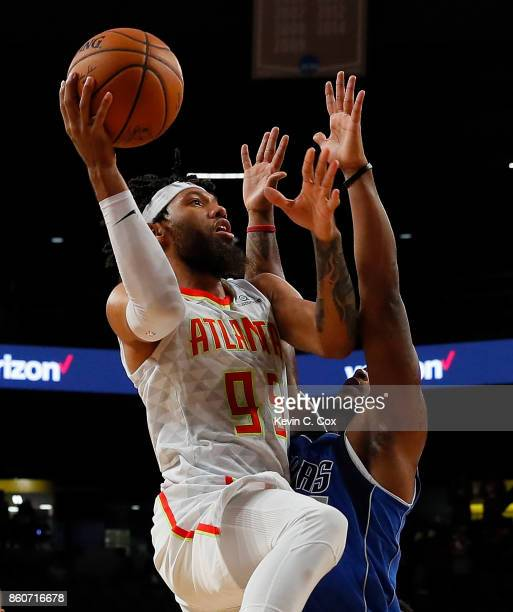 DeAndre' Bembry of the Atlanta Hawks drives against Maalik Wayns of the Dallas Mavericks at McCamish Pavilion on October 12 2017 in Atlanta Georgia...