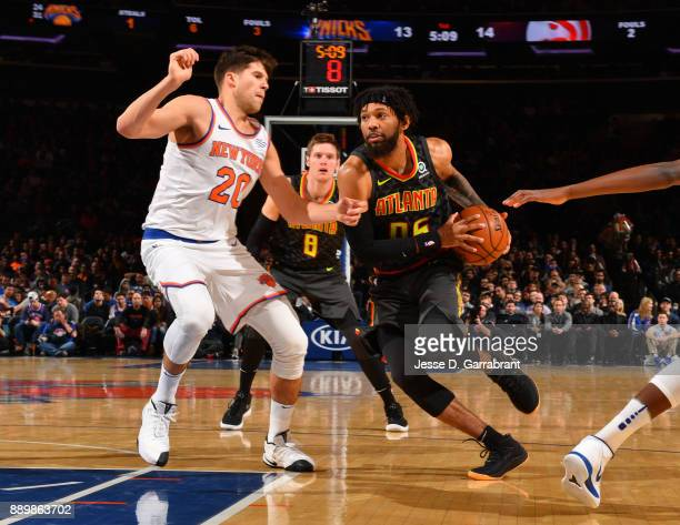 DeAndre' Bembry of the Atlanta Hawks drives to the basket against the New York Knicks at Madison Square Garden on December 10 2017 in New York New...