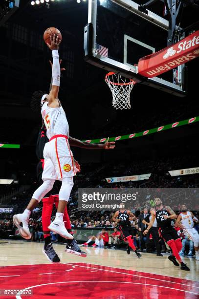DeAndre' Bembry of the Atlanta Hawks dunks against the Toronto Raptors on November 25 2017 at Philips Arena in Atlanta Georgia NOTE TO USER User...
