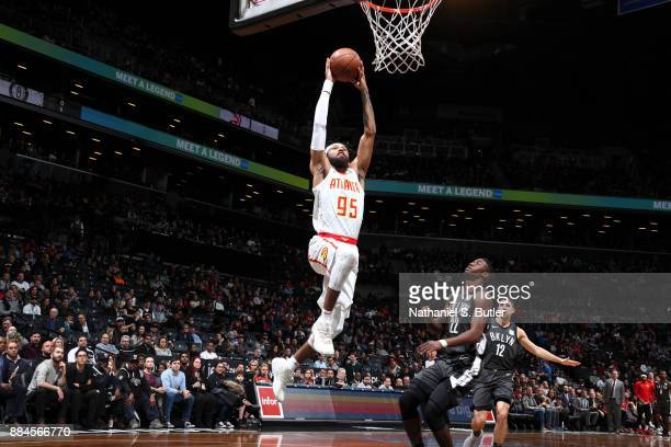 DeAndre' Bembry of the Atlanta Hawks dunks the ball against the Brooklyn Nets on December 2 2017 at Barclays Center in Brooklyn New York NOTE TO USER...