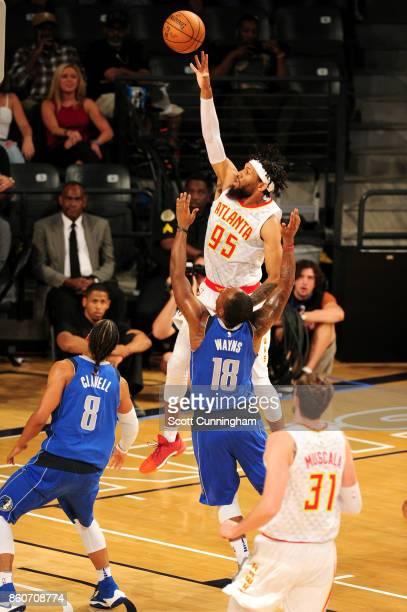 DeAndre' Bembry of the Atlanta Hawks goes to the basket against the Dallas Mavericks on October 12 2017 at McCamish Pavilion in Atlanta Georgia NOTE...