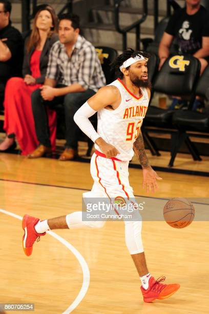 DeAndre' Bembry of the Atlanta Hawks handles the ball against the Dallas Mavericks on October 12 2017 at McCamish Pavilion in Atlanta Georgia NOTE TO...