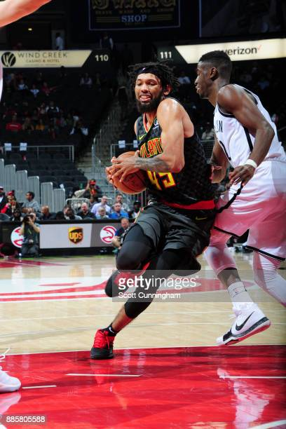 DeAndre' Bembry of the Atlanta Hawks handles the ball against the Brooklyn Nets on December 4 2017 at Philips Arena in Atlanta Georgia NOTE TO USER...