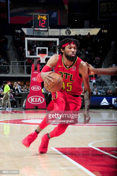 DeAndre' Bembry of the Atlanta Hawks handles the ball against the Orlando Magic on December 9 2017 at Philips Arena in Atlanta Georgia NOTE TO USER...